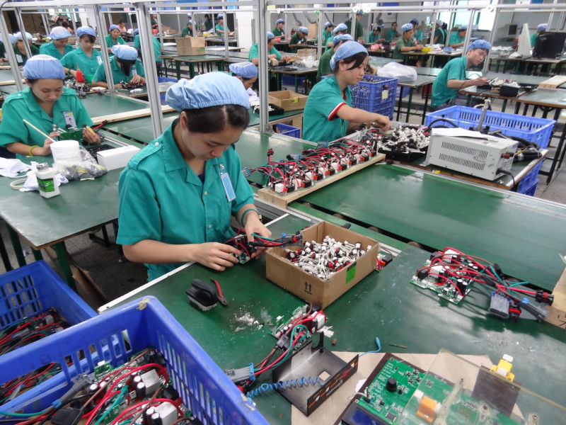 Assembling on the production line in overseas manufacturer.